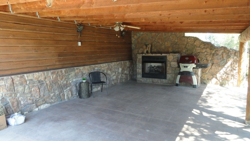 Attached covered patio w propane  fireplace