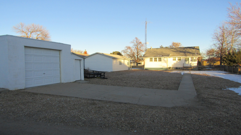 View of backyard/house/2 garages
